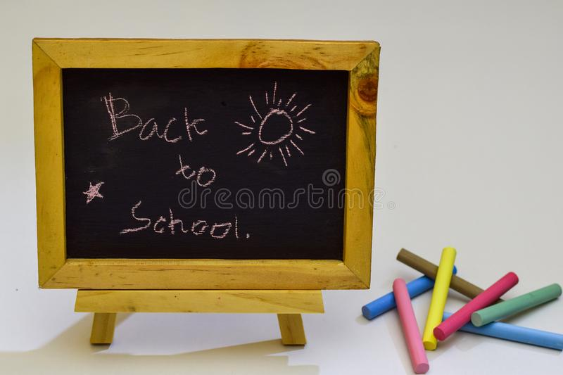 Vintage rectangular chalkboard with colorful chalk isolated on white background stock photo