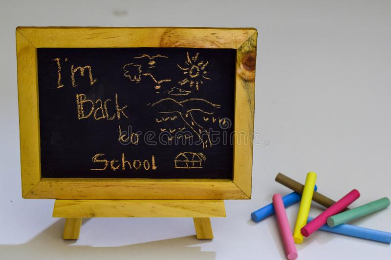 Vintage rectangular chalkboard with colorful chalk isolated on white background royalty free stock photos