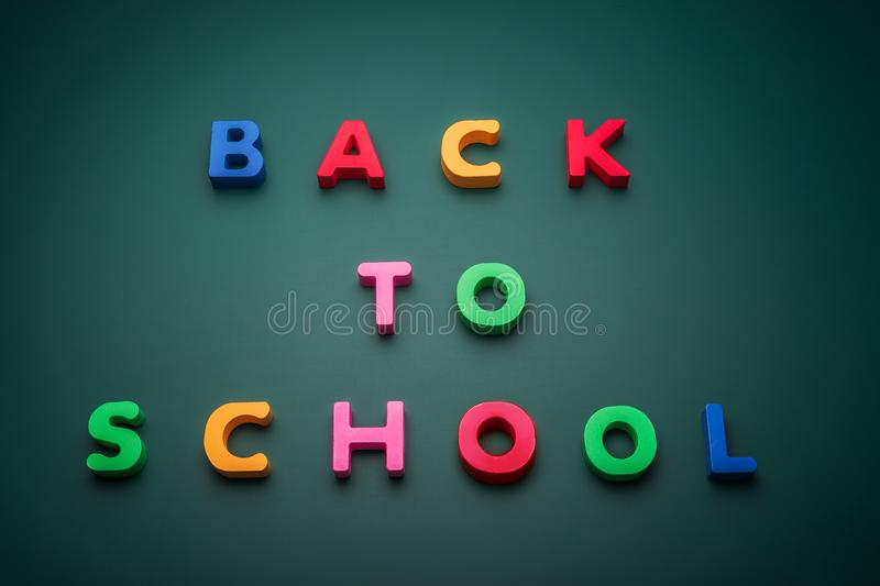Back to school text write with wooden alphabet in blackboard royalty free stock photo