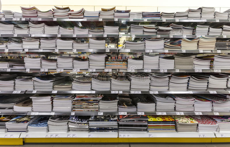 Back to school. Wall notebooks from school. Shelving shop. stock image