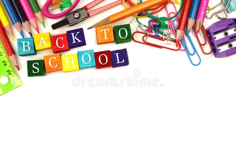 Back To School wooden blocks with school supplies border stock photography