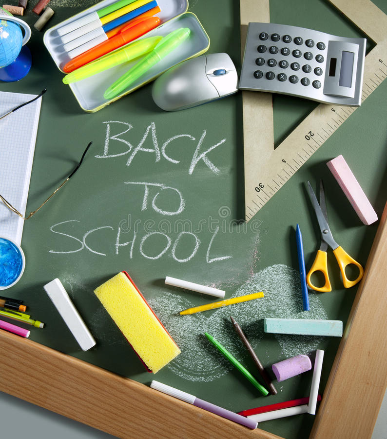 Back to school written blackboard green board. Back to school written in green blackboard education concept still life stock images