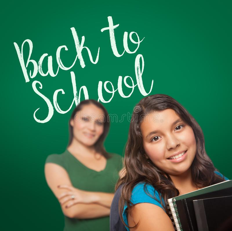 Back To School Written On Chalk Board Behind Proud Hispanic Mom royalty free stock photography