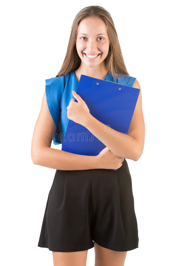 Back to School. Young woman carrying notebooks in her arms, isolated in white royalty free stock photography