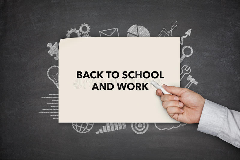 Back to shool and work Concept on black blackboard royalty free stock photography