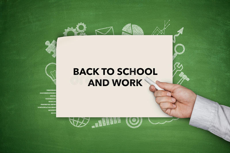 Back to shool and work Concept on green blackboard royalty free stock images