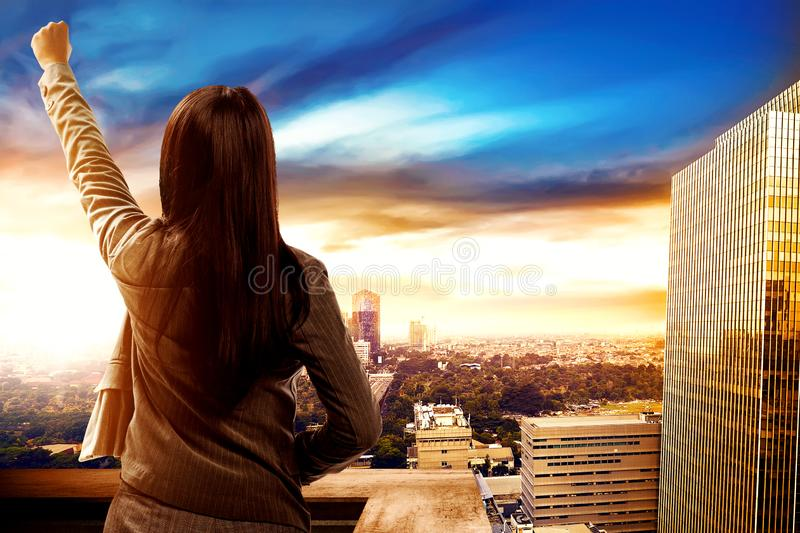 Back view of asian business woman celebrate her successful royalty free stock photography