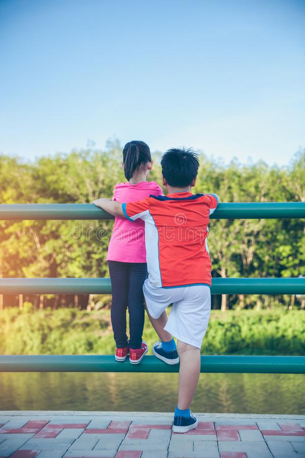 Children smiling and hugging each other. Loving and bonding of s royalty free stock images