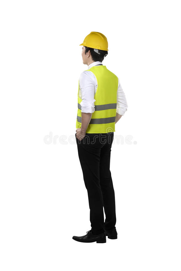 Back view of asian worker wearing safety vest and yellow helmet. Isolated over white background stock images