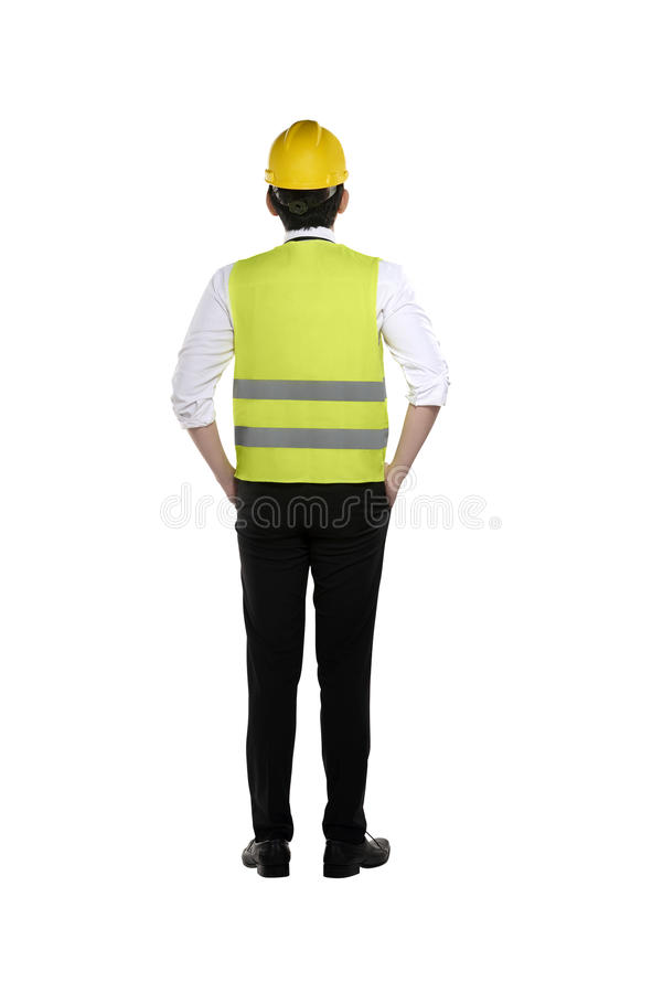 Back view of asian worker wearing safety vest and yellow helmet. Isolated over white background stock photography