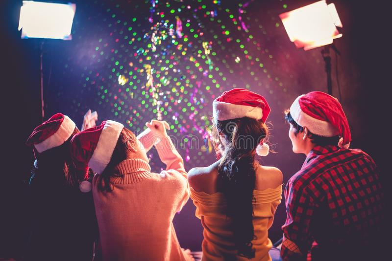 Back view of Asian young peoples who celebrating Christmas and New Year. Holiday and Happiness concept. Friendship and Relax theme royalty free stock image