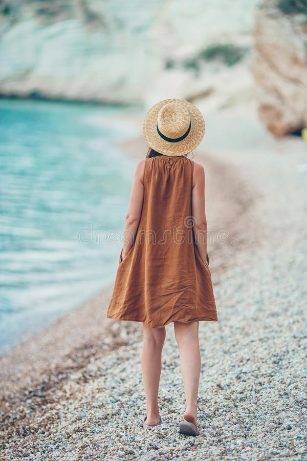 Young beautiful woman on white tropical beach. royalty free stock images