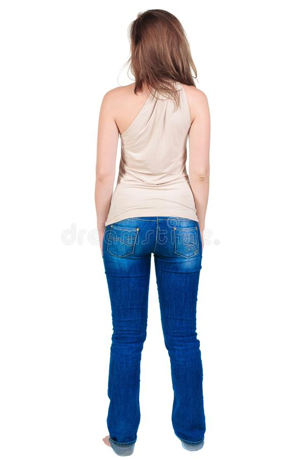 Back view of beautiful yong woman looks ahead. rear royalty free stock photo