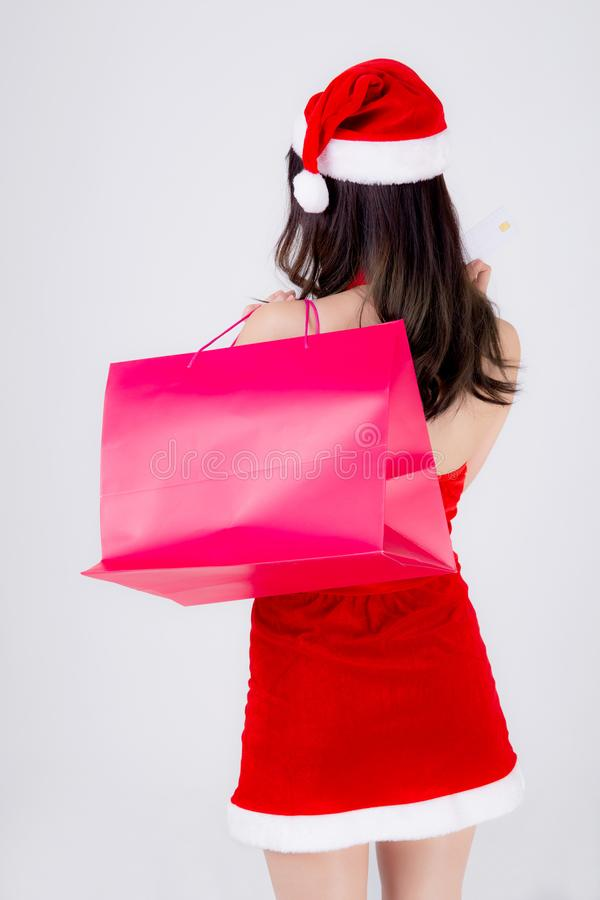 Back view beautiful young asian woman thinking and holding credit card and shopping bag with excited isolated stock images