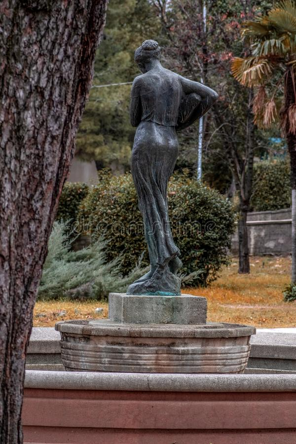 Back view of black woman statue carrying water in a bottle royalty free stock photo