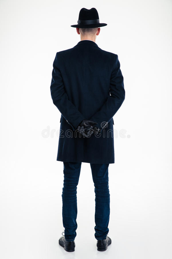 Back view of business man in black clothes and hat stock photography