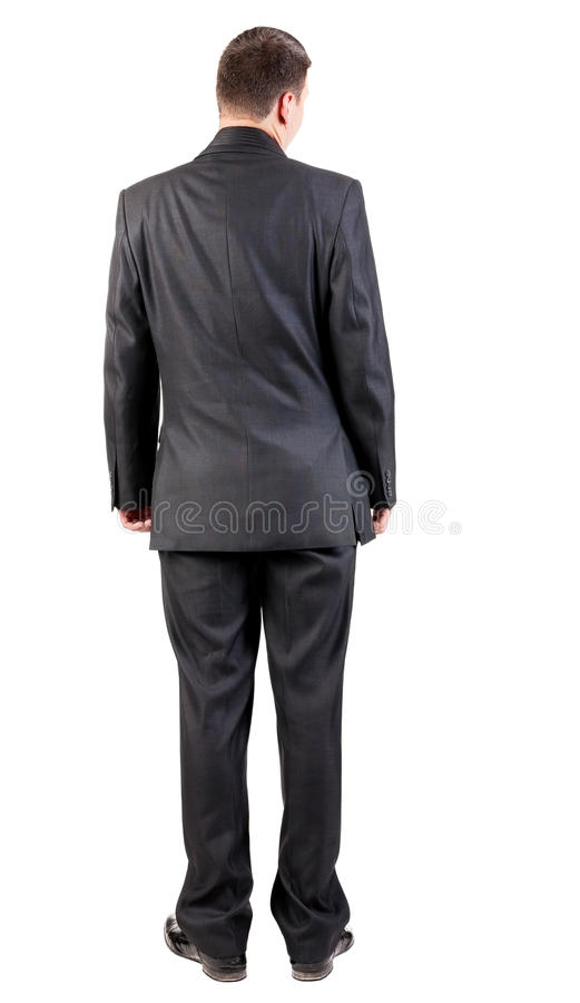 Back view of business man in black suit watching. royalty free stock photos