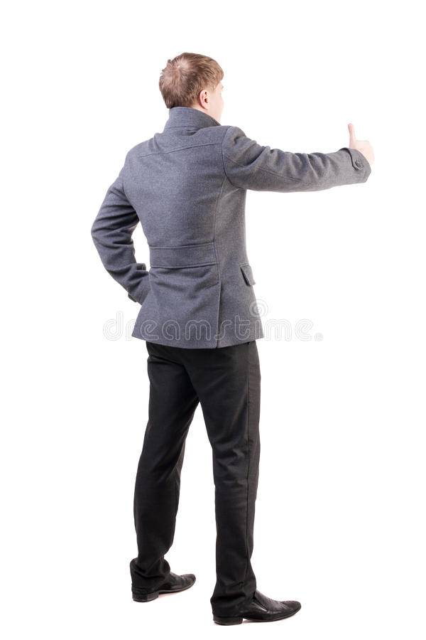 Download Back View Of  Business Man In Coat Shows Thumbs Up Stock Image - Image: 29949793