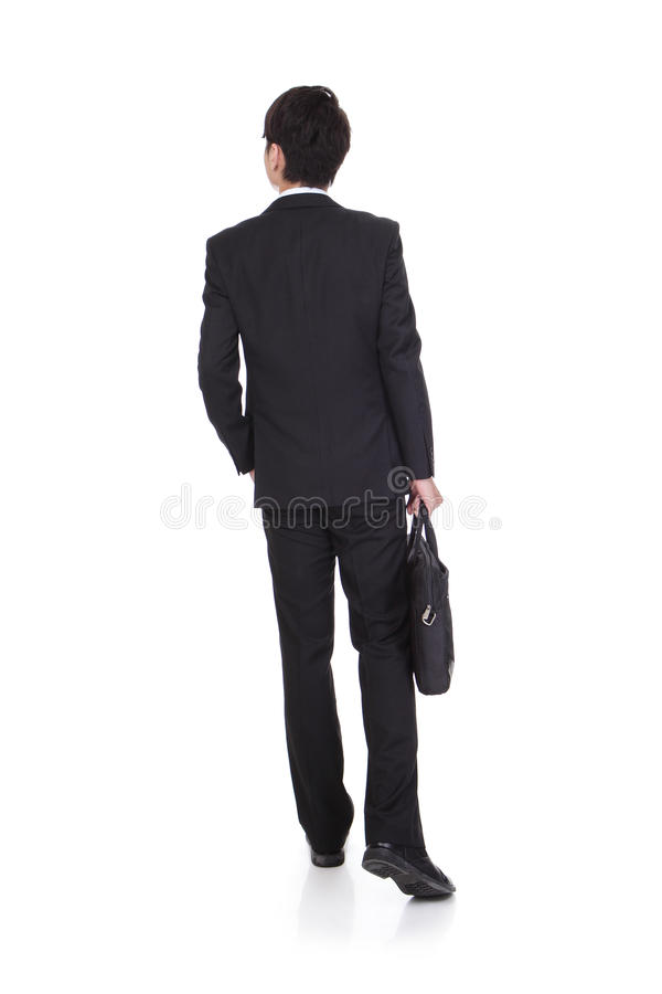 Back view of a business man walking stock images