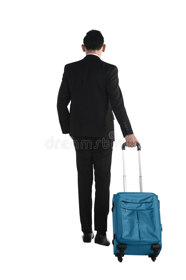 Back view of business man walking with suitcase stock photo