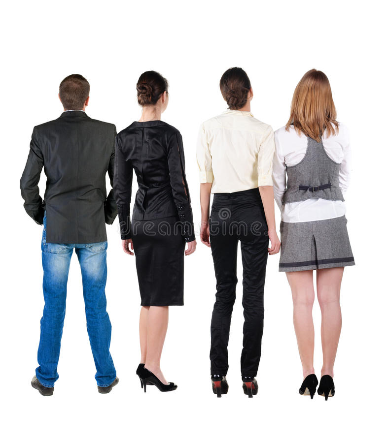 Back view of business team looks at wall. royalty free stock photos