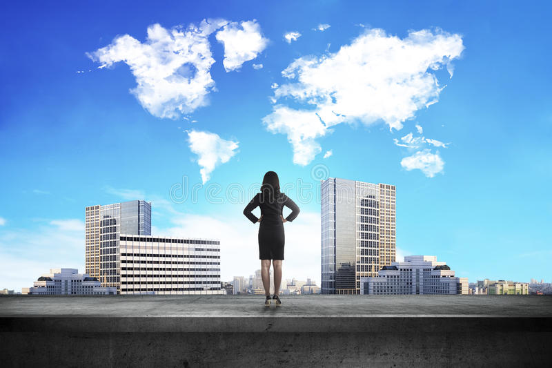Back view of business woman looking at world shape cloud royalty free stock photos