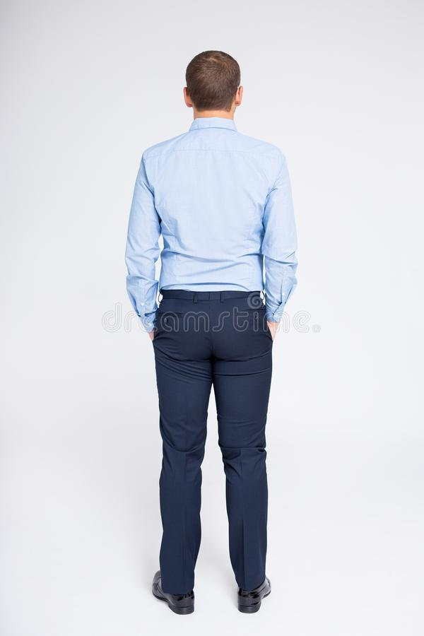 Back view of businessman over gray background royalty free stock images