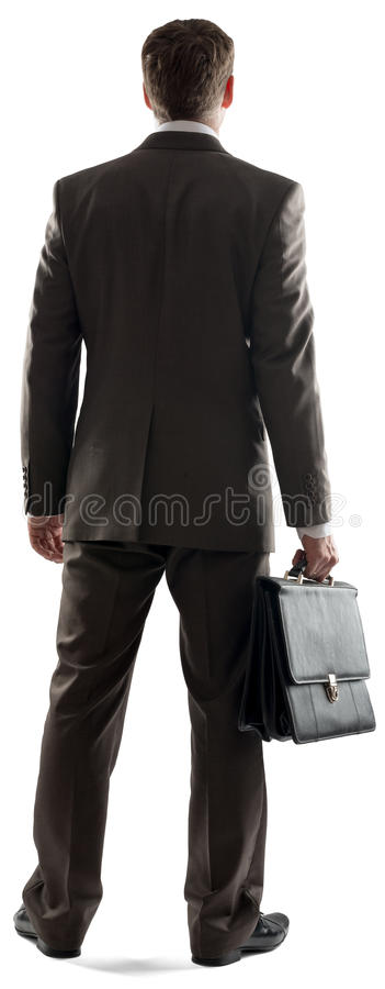 Back view of businessman standing with briefcase stock photo