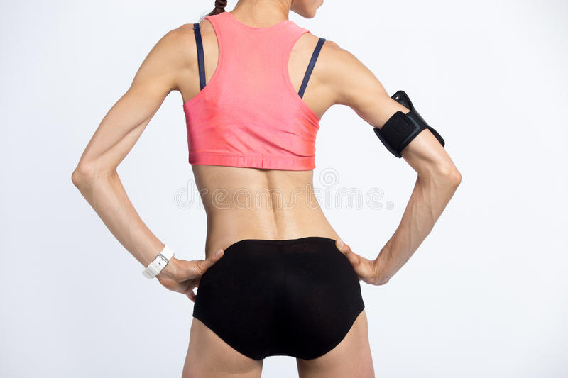 Back view close-up of beautiful fit female body royalty free stock photo
