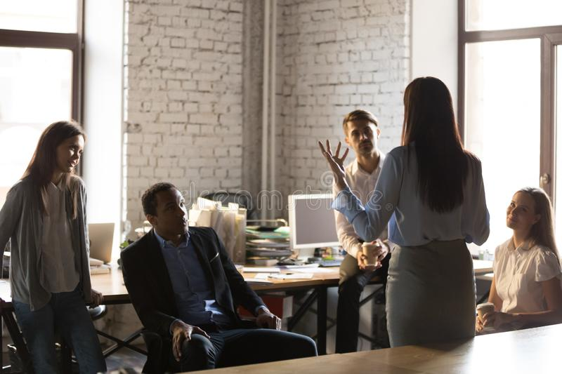 Confident female team leader hold casual meeting royalty free stock images
