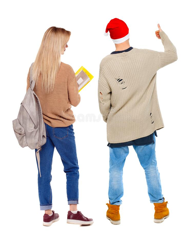 Back view of couple couple in sweater showing thumbs up royalty free stock photos
