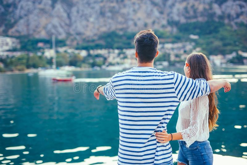 Back view of a couple of tourists sightseeing in a travel destination royalty free stock photo