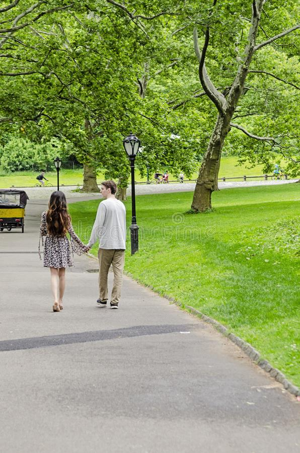 Couple walking in Central Park in New York City stock images