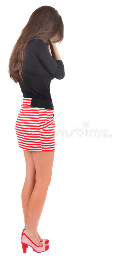 Back view of crying young beautiful woman. royalty free stock photo