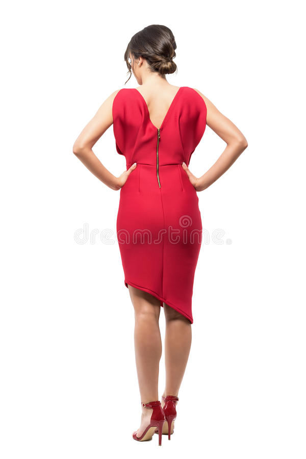 Back view of elegant woman in red evening dress with hands on hips. Full body length portrait isolated on white studio background stock photos