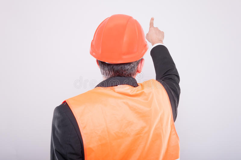 Back view of engineer pointing something stock photo