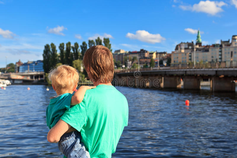 Back view of father and son looking at Stockholm stock image