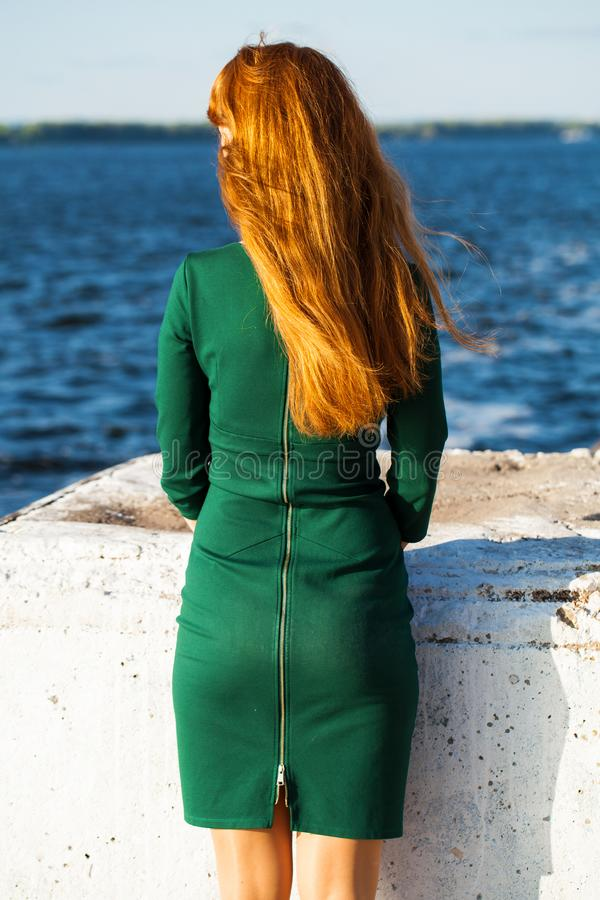 Back view female red-haired girl. Back view female red-haired woman stock images
