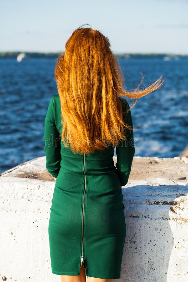 Back view female red-haired girl. Back view female red-haired woman stock photo