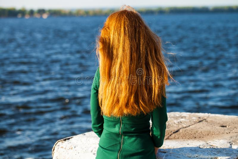 Back view female red-haired girl. Back view female red-haired woman stock photography