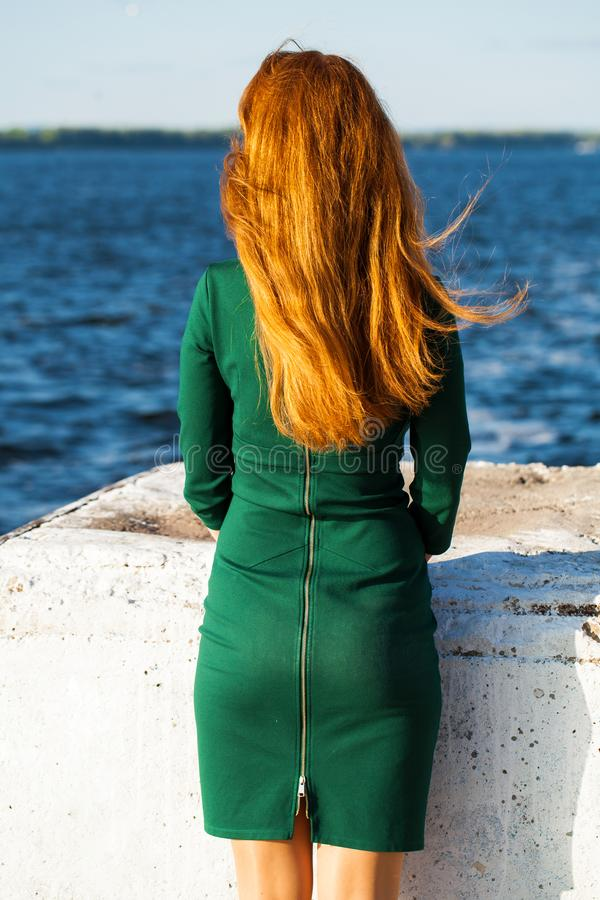 Back view female red-haired girl. Back view female red-haired woman royalty free stock photography