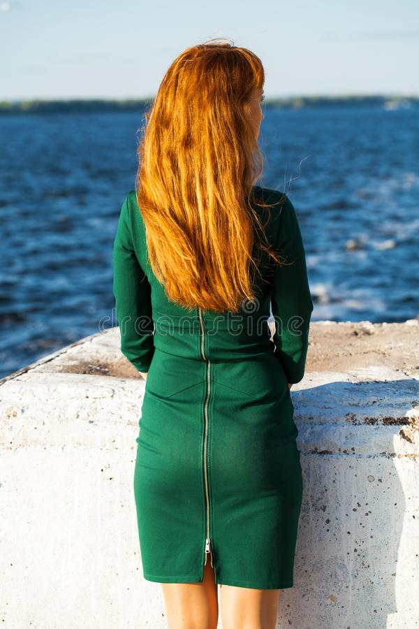 Back view female red-haired girl. Back view female red-haired woman royalty free stock images