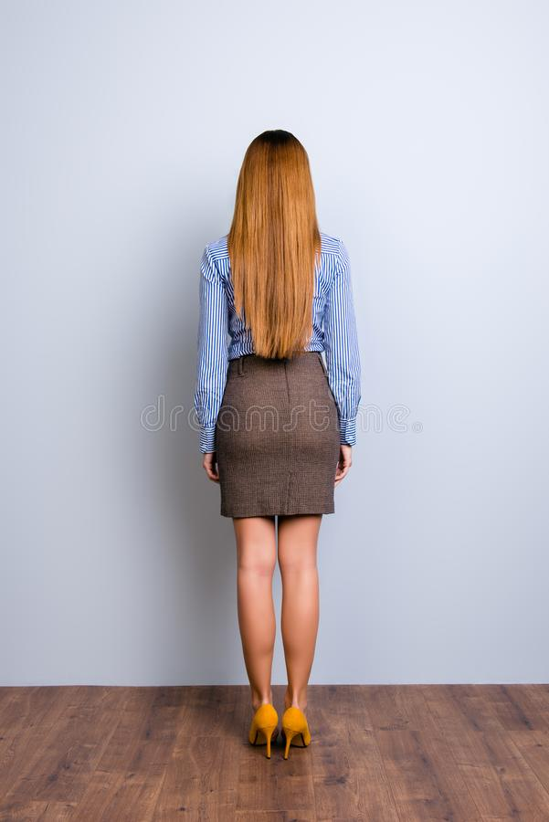 Back view full length portrait of blond business lady in formal stock photo