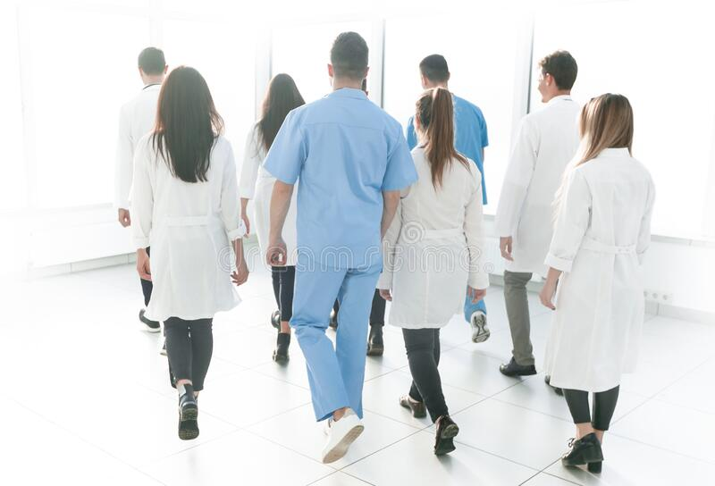 Back view. a group of doctors rushing to the call. royalty free stock photo