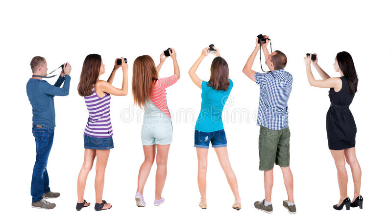 Back view group of people photographed attractions. Rear view team people collection. backside view of person. Isolated over white background. A group of stock photos
