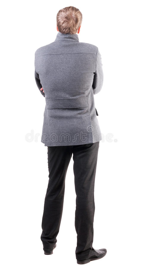 Back view of handsome business man in coat stock photo