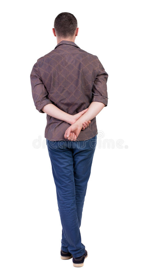 Back view of handsome man in shirt looking up. Standing young guy in jeans. Rear view people collection. backside view of person. Isolated over white stock photo
