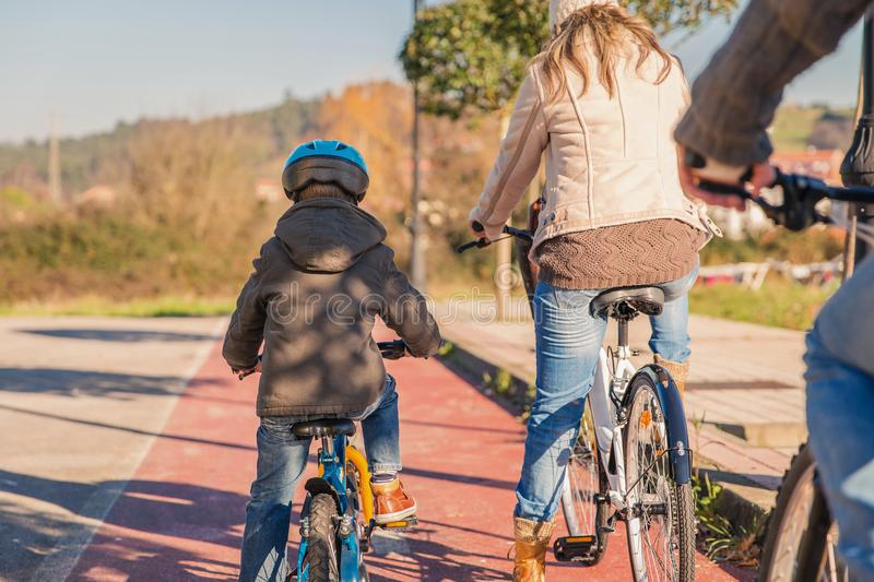 Family with child riding bicycles in the nature stock photos