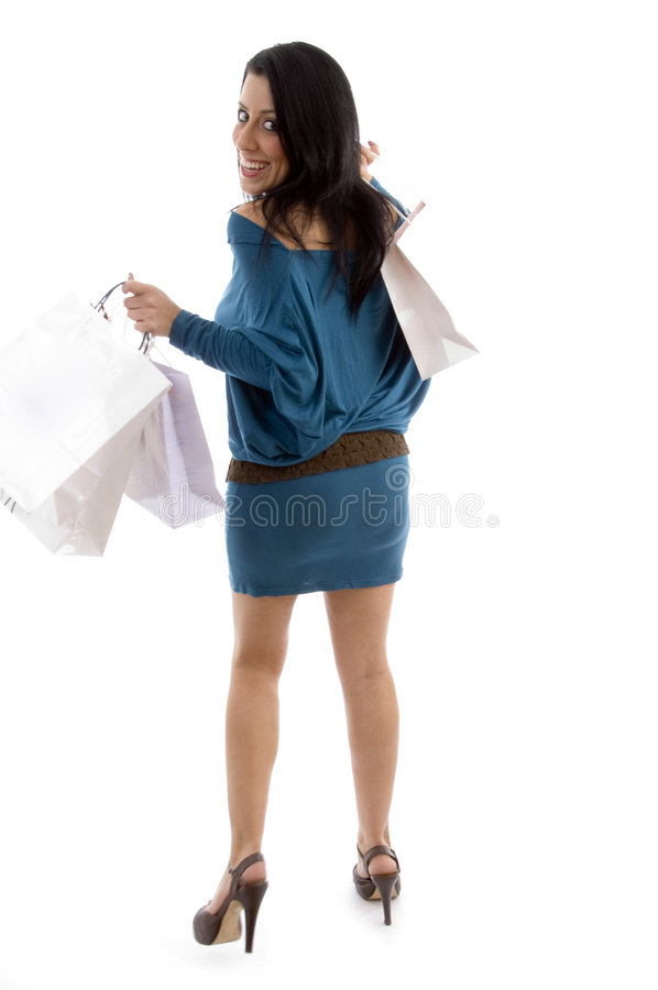 Download Back View Of Happy Model Holding Carry Bags Stock Photo - Image of caucasian, brunette: 7364856