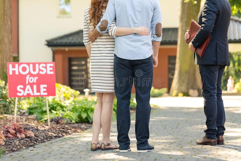 Back view of hugging couple stock photography